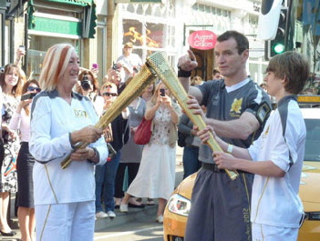 The torch handover from Liz Twose to Jacob Brownhill